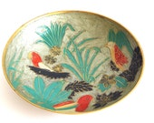 exotic metal bowl with birds