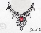 Elegant necklace in black seed beads and red acrylic stone by Selene de Viollet
