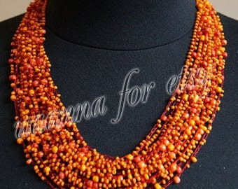 Necklace handmade beaded orange. Technique crochet.