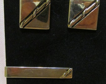 Cuff links and tie bar set gold tone Swank