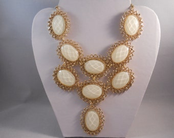 Bib Necklace with off White and Gold Tone Pendants on a Gold Tone Chain