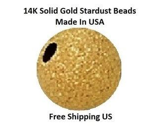14 K Gold Stardust 5 MM /   4 P Round  Beads              6105