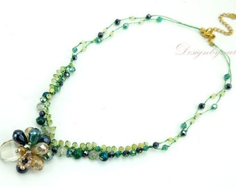 Green crystal on silk necklace.