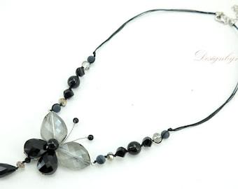 Black butterfly crystal on silk necklace.
