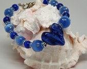 Oh, Valentine!  MY HEART is BLUE!  Hand Beaded Lampwork Glass Cats Eye Beads and Rhinestone Bracelet