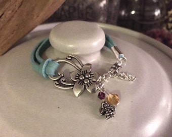 Teal hibiscus leather bracelet