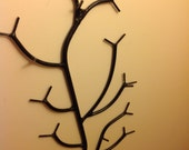 """Vertical mounted wall branch 24"""" long 13"""" wide finished in Semi gloss black finish. Color matched mounting screws included."""