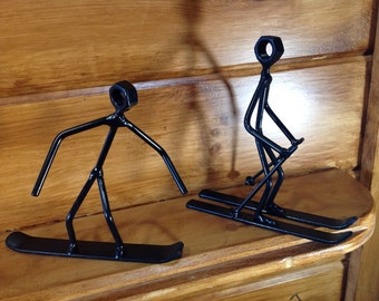 """skier figure 6"""" tall available with straight down hill or snow plow skis original one of a kind art"""