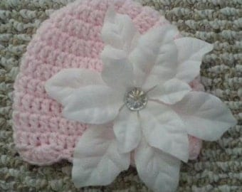 Crochet pink baby girl hat with white flower