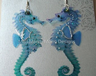 Seahorse earrings, iridescent with sterling silver ear wires, various colours. Latch back and clip on version available