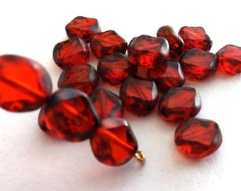 9 mm Czech Orange Polished  Diamond Oval Beads