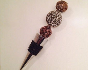 Wine stopper with metal beads