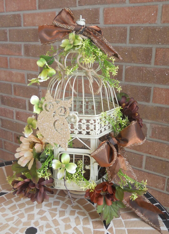 Antique cream bird cage centerpiece floral by twenty design