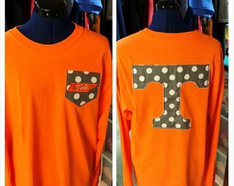 Pocket tee with a big t on the back