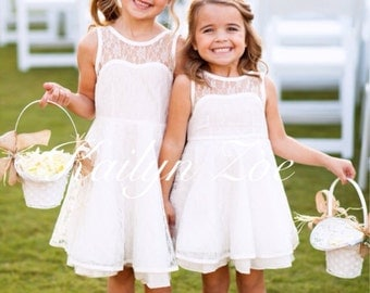 The Emma Elizabeth Lace Flower Girl Dress for toddlers and girls from 2-12 years old, black, peach, white and ivory
