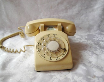 Beige rotary dial desk phone, vintage telephone,  western electric, working rotary dial phone