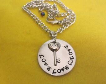 "Beatles ""Love, Love, Love"" necklace"