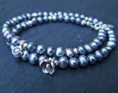 Freshwater pearl bracelet with thai silver heart and flower charms and small faceted beads