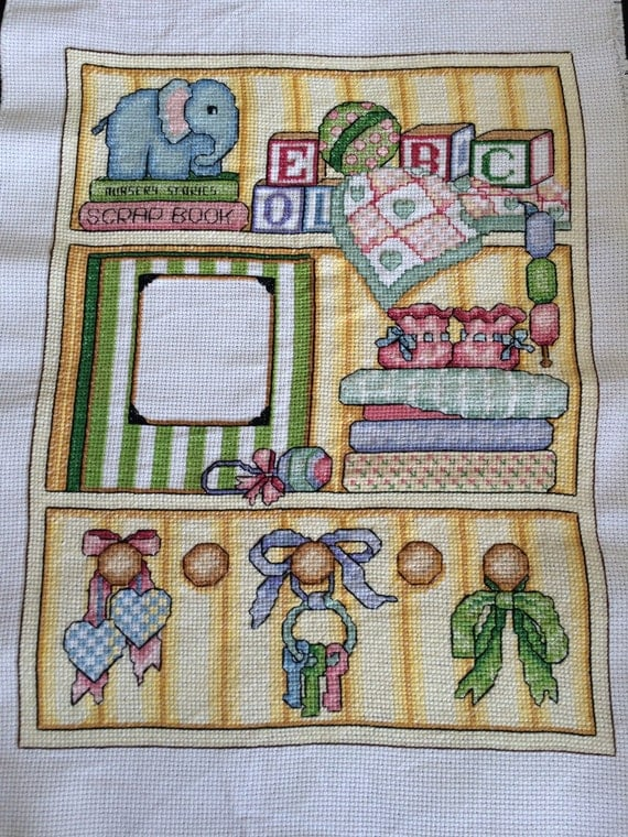 Birth sampler completed cross stitch