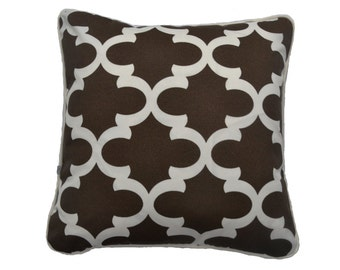 Quarterfoil Outdoor pillow cover in chocolate & cream . Double sided , framed with cream piping detail with invisible zip locate at the base