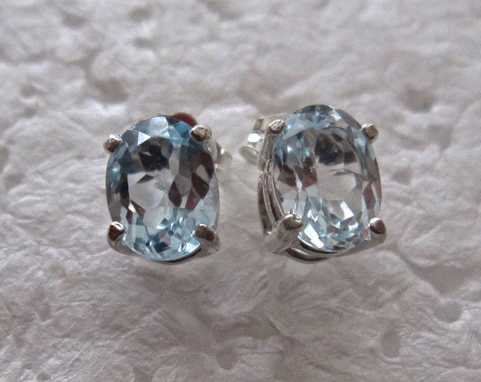 Blue Topaz Stud Earrings, 8x6mm Oval, Natural, set in Sterling Silver E728