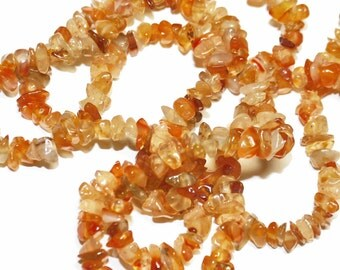REDUCED: Carnelian chips.  Approx. 6-9mm across  (17 inch strand)