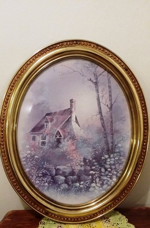 vintage home interior cottage scene with oval gold frame