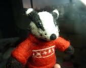 Needle felt badger in Christmas jumper