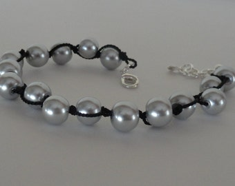 Silver pearl bracelet on black silk cord