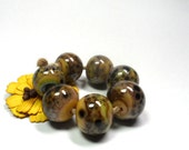 Lampwork.Glass bead handmade. Beads brown, green, marsh, bronze, pistachio.