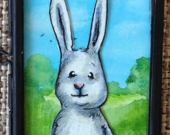 Original illustration of a White Bunnie in a little glas frame