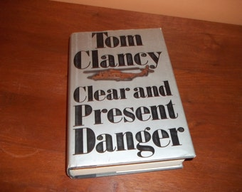 Clear and Present Danger - Tom Clancy  - 1989 / Hard Cover with Dust Jacket Clear and Present Danger / Tom Clancy Book