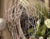 White washed metal angel wings