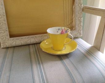 Vintage yellow teacup and saucer set fine bone china