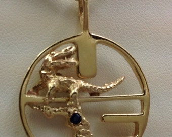 Large 14kt vintage UF pendant with sapphire.