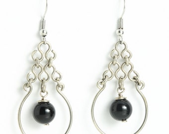 Large german silver earrings with an Onyx in the center