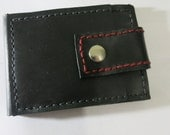 Black, leather, slim, bi-fold wallet with snap closure and red accent stitching.