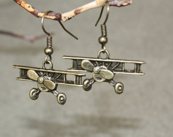 Bi Plane earrings perfect for that pilot gift detailed airplane soars in the sky and dangles under your ears