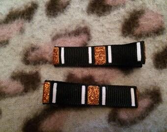 Orange and black glittered hair clips