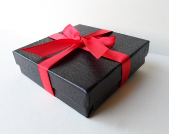 Small Jewelry Gift Box for the item you ordered to be packaged in.  3.5 Inches Square Box, Black Box with Red Ribbon
