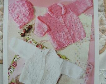 Baby Cardigans,Bonnet And Socks Knitting Pattern In DK