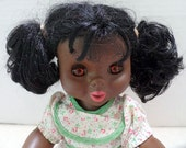 Pretty little black doll with pigtails.  She is dated 1969 or 89, I can't be sure which.