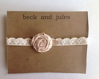 Girl blush pink rosette headband on stretch lace