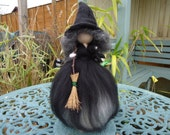 Beautiful Needle Felted Witch. Merino Wool over a metal armature on a wooden stand.