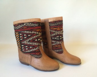 Handcrafted leather kilim boots.