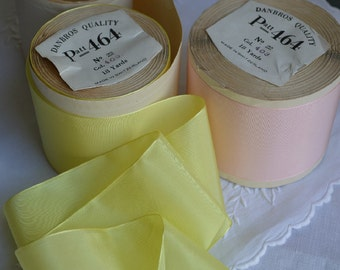 Yard of Antique taffeta ribbon unused, yellow or pink, from the 1930s