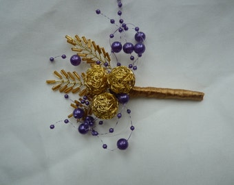 Purple and gold boutonniere with gold seed bead leaves, gold wire balls, seed bead 'leaves' and puple bubble pearls Grooms boutonniere..