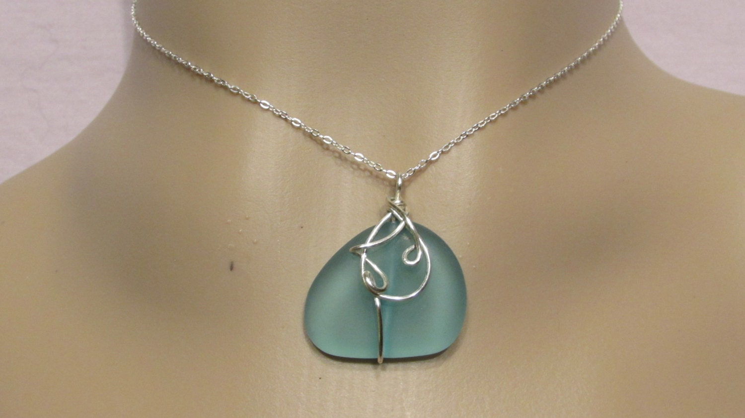 light blue sea glass pendant wire wrapped in by