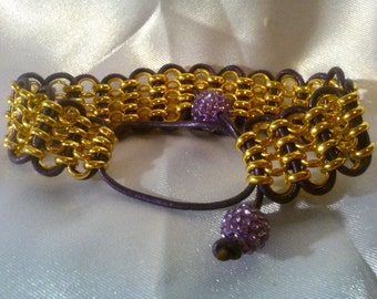 Gold Chain and Purple Leather Lacing Make for a Royal Looking Bracelet
