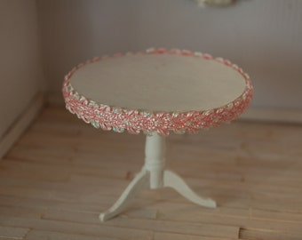 Round Shabby table with decorative pink trim